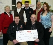 Lotto Winner Receives Cheque